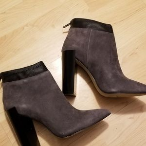 Saks Fifth Avenue boots.